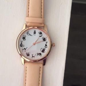 Watch with cat design.